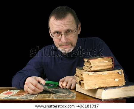 portrait of an elderly man with old books and bank notes - stock photo