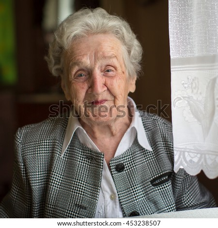 Portrait of an elderly woman. - stock photo