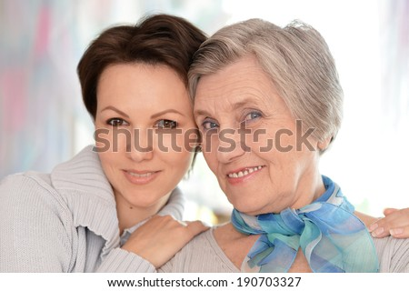 Portrait of an elderly woman and a young woman - stock photo