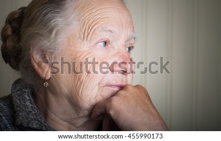 Portrait of an elderly woman. Toned. - stock photo