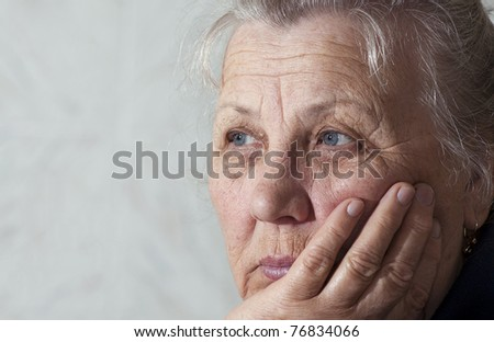 Portrait of an elderly woman with a sad look. Close-ups - stock photo