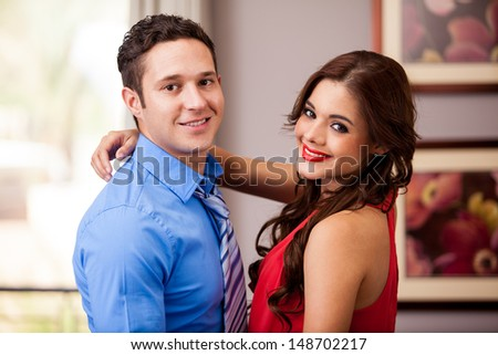 Portrait of an elegant couple all dressed up and ready to go out for dinner - stock photo