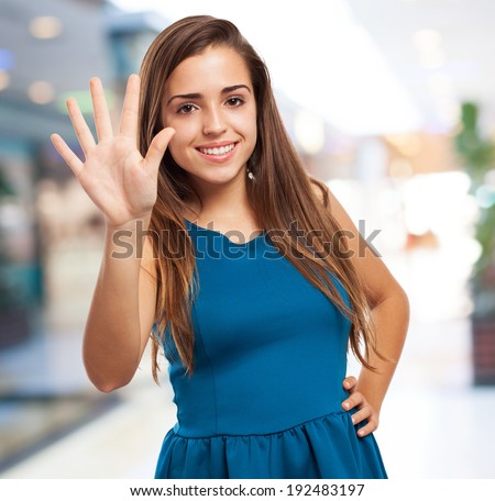 portrait of an elegant young girl counting with her fingers - stock photo