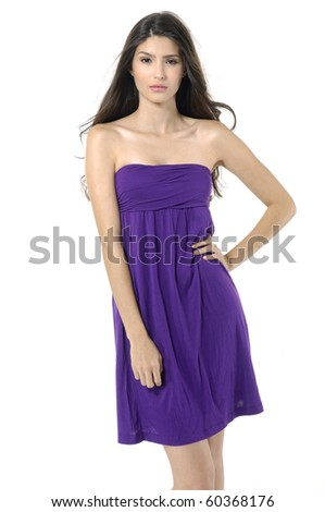 portrait of an elegant young woman posing against white background - stock photo
