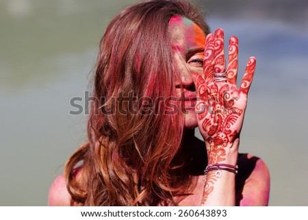 Portrait of an emotional girl with paint on her face, India, Holi festival, Rishikesh  - stock photo
