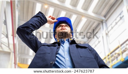 Portrait of an engineer at work in a factory - stock photo