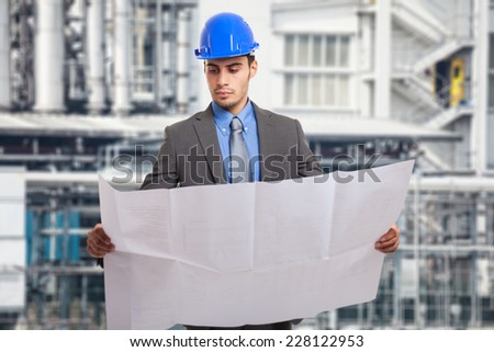 Portrait of an engineer holding a blueprint - stock photo