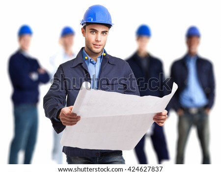 Portrait of an engineer holding a drawing in front of his team - stock photo