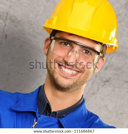 Portrait Of An Engineer Near Wall - stock photo
