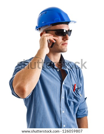 Portrait of an engineer talking at phone. Isolated on white - stock photo