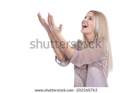 Portrait of an enthusiastic beautiful young woman raising hands up in the air. - stock photo