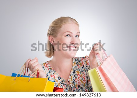 Portrait of an excited woman with shopping bag - stock photo