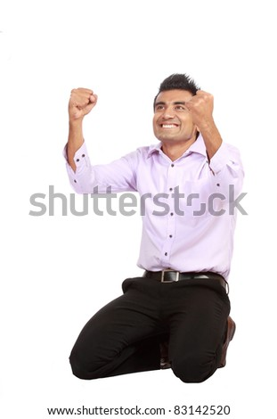 Portrait of an excited young business man celebrating success with good expression against white background - stock photo