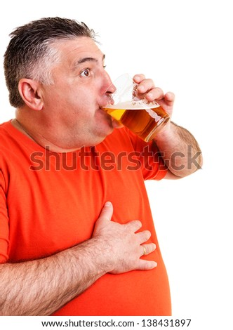 Portrait of an expressive fat man drinking beer isolated on white background - stock photo