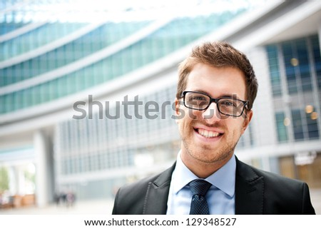 Portrait of an handsome businessman in an urban setting - stock photo