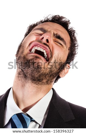 portrait of an handsome businessman making a face isolated over a white background - stock photo