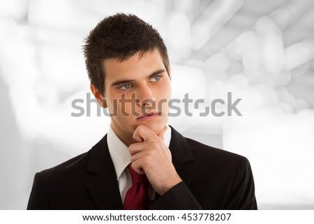 Portrait of an handsome pensive businessman - stock photo
