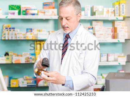 Portrait of an handsome pharmacist at work - stock photo