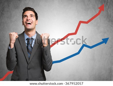 Portrait of an happy businessman standing in front of rising arrows - stock photo