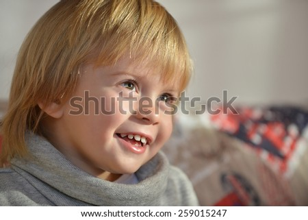 Portrait of an happy child aged three years old  - stock photo