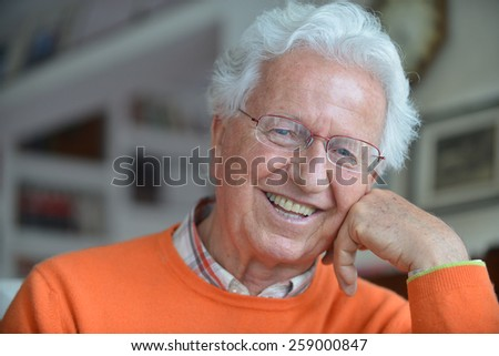 Portrait of an happy man in his house - stock photo