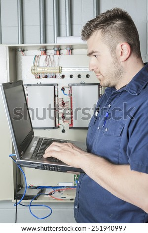 Portrait of an happy worker in a factory - stock photo