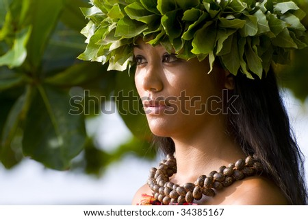 portrait of an Hawaiian teenager dressed in traditional cloths - stock photo