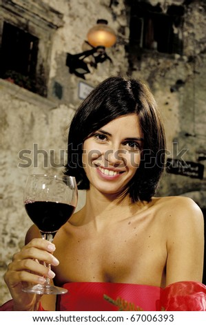 portrait of an hispanic woman with glass of wine - stock photo