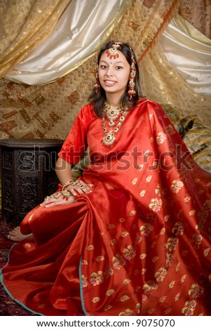 Portrait of an Indian beauty wearing saree and bridal jewelry - stock photo