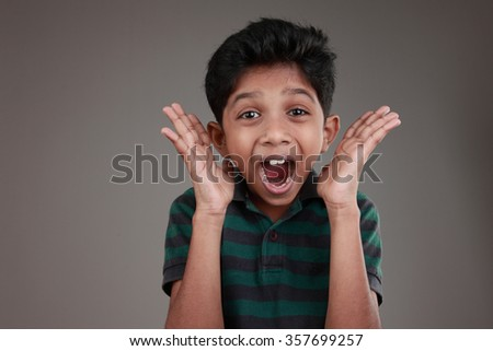 Portrait of an Indian boy shouting loud - stock photo