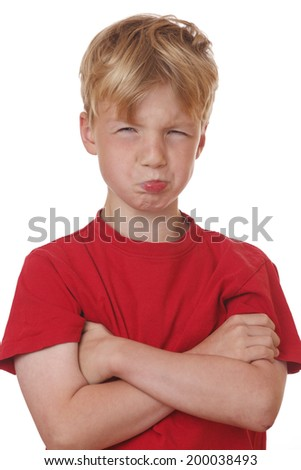 Portrait of an offended young boy on white background - stock photo