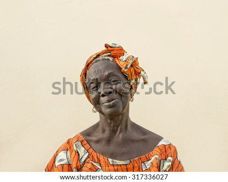 Portrait of an old lady wearing a traditional headdress - stock photo