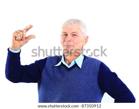 Portrait of an old man holding something imaginary in his hands on white - stock photo
