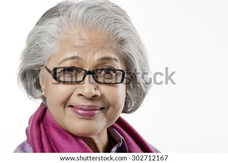 Portrait of an old woman - stock photo