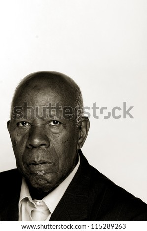 Portrait of an older African-American man in a suit - stock photo