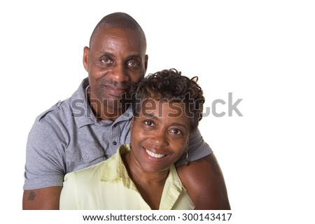 Portrait of an older couple facing embracing, isolated - stock photo