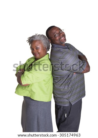 Portrait of an older couple standing back to back isolated - stock photo