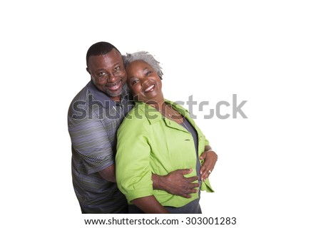 Portrait of an older couple standing close isolated - stock photo