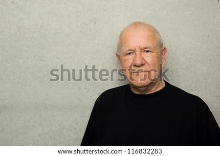 Portrait of an older man wearing black t-shirt - stock photo