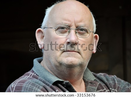portrait of an older unshaven male - stock photo