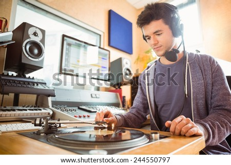 Portrait of an university student with a turn table in the studio of a radio - stock photo