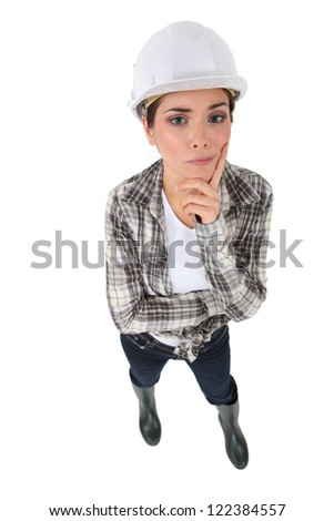 Portrait of an unsure tradeswoman - stock photo