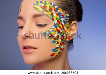 portrait of an unusual make-up. woman with creative make-up in the multi-colored point - stock photo