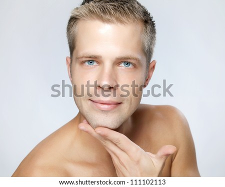 Portrait of an young handsome man - stock photo