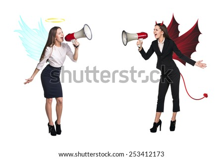 Portrait of angel and devil girls with megaphone and copyspace between them on white background - stock photo