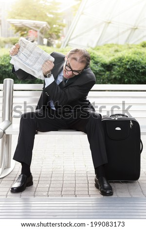 Portrait of Angry businessman with newspaper in his hands  - stock photo