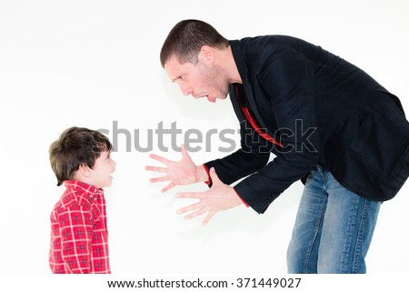 portrait of angry father scolding his son, isolated on white background - stock photo
