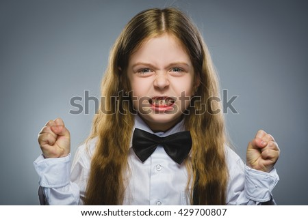 Portrait of angry girl with hand up yelling isolated on gray background. Negative human emotion, facial expression. Closeup - stock photo