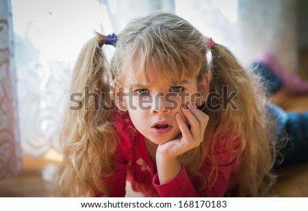 portrait of angry little girl - stock photo