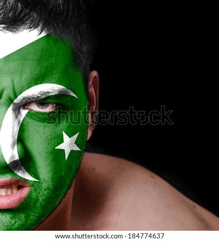 Portrait of angry man with painted flag of Pakistan - stock photo